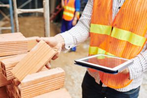 Construction engineer checking building materials